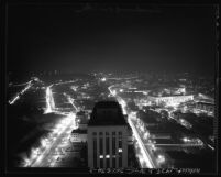 Nighttime cityscape seen from city hall tower looking north, during dim-out in Los Angeles, Calif., 1943
