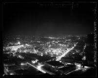 Nighttime cityscape seen from city hall tower looking northeast, during dim-out in Los Angeles, Calif., 1943