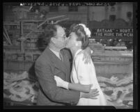 Martin W. Amador gets a kiss from Marguerite Chapman for War Bonds drive in Los Angeles, Calif., 1943