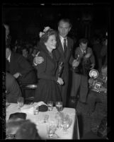 Actors Gary Cooper and Joan Fontaine holding their Oscars at Academy Awards after party, 1942