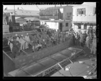 California Shipbuilding yard workers at phony launch of cardboard ship S.S. Absentee, 1943