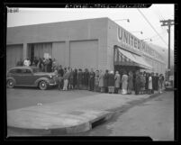 Long line of people waiting to obtain meat during first day of war rationing in Los Angeles, Calif., 1943