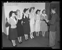 Capt. Robert L. Woods administers oath to the first Southland W.A.A.C. inductees, 1942