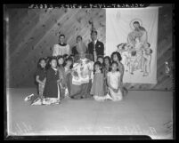 Archbishop John J. Cantwell with children at dedication for Chinese Catholic Social Center, 1942