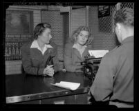 Actress Frances Farmer being booked by sheriff Vivienne Hassack Los Angeles, Calif., 1943