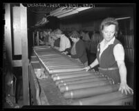 Women Ordinance Workers inspecting cartridge cases in Los Angeles, Calif., 1943