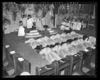 St. John's Seminary students prostrated before altar as they are being ordained in Los Angeles, Calif., 1943