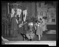 Student receiving banner from Archbishop Cantwell for support of Catholic foreign missions, Los Angeles, Calif., 1943