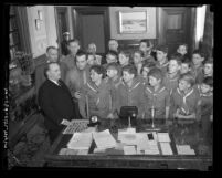 Mayor Frank L. Shaw meeting with Boy Scouts in his office, Los Angeles, Calif., circa 1933