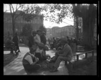 Shoeshine boys working in the Old Plaza of Los Angeles, circa 1930