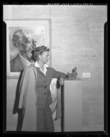 "Joyce Creighton with her work ""Reclining Figure"" in Los Angeles, Calif., 1944"