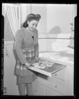 Movie starlet Elena Verdugo preparing a Spanish dinner in Los Angeles, Calif., circa 1944