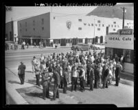 Strikers meeting in front of the Ideal Cafe across the street from Warner Brothers Studio in Los Angeles, Calif., 1945