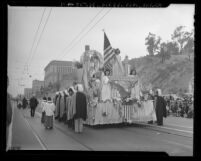 Knights of Columbus accompanying float carrying Blessed Sacrament in Catholic parade marking victory over Nazis, Los Angeles, Calif., 1945