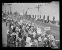 Film strike pickets on street near entrance to Warner Bros. Studio, 1945