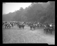 San Fernando Horse Owners Association listen to sermon delivered from oxcart in Providencia Rancho, Calif., 1945