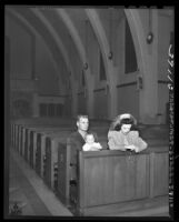 Marine Lt. Tom Bussjager with his wife and child alone in St. Michael Church praying in Los Angeles, Calif., 1945