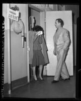 Coy August, in women's clothing with police officer in Los Angeles, Calif., 1946