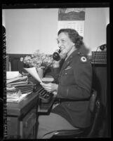 WACS lieutenant Carol McClement resuming job as secretary to Supervisor John Anson Ford in Los Angeles, Calif., 1946