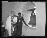M. L. Calac, Indian bell ringer of Padua Mission, sounds old San Fernando Mission bell, Los Angeles, 1946