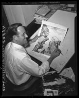 Bruce Russell at his drawing table showing Pulitzer Prize winning cartoon, 1945