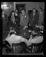 Actress Hedy LaMarr and John Loder in courtroom, confronting men suspected of robbing their house in Los Angeles, Calif., 1946