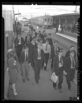 Pacific Electric employees walking off job at Sixth and Main Sts. Terminal in sympathy strike, Los Angeles, Calif., 1946
