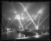 Navy battleships, cruisers, air craft carriers, and destroyers putting on light show in Long Beach Harbor, Calif., 1946