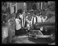 Bishop Ernest Vincent Shayler blessing automobile at St. Thomas Episcopal Church in Los Angeles, Calif., 1946