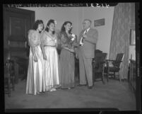 City council president George Moore with three contestants for queen of Philippines' independence day, Los Angeles, Calif., 1946