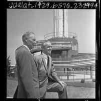 Marineland executives, Henry U. Harris and William F. Monahan standing before Marineland Sky Tower, Calif., 1966
