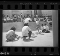Filipino folk dancers performing tinikling dance on steps of Los Angeles City Hall, 1966