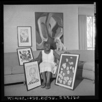 Artist Ruth G. Waddy with some of her work, Los Angeles, Calif., 1966