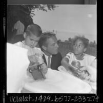 Sergeant Shriver with two children in Operation Head Start program in Pacoima, Calif., 1966
