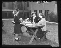 Westlake girls preparing packages for adopted school in Europe, Los Angeles, Calif., 1949
