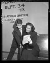 Twelve-year-old Dean Stockwell and Colleen Townsend waiting at court for contract approval in Los Angeles, Calif., 1949