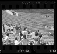 Confrontation between a white youth and group of African Americans during 1966 Teen Post Junior Olympics in Los Angeles, Calif.