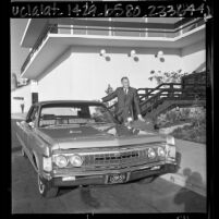 Lynn A. Townsend, president of Chrysler Corp., showing company's 1967 Imperial, Calif.