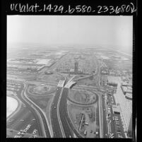 Aerial view of Los Angeles International Airport and surrounding roadways, 1966