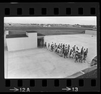 Students walking out of Robert H. Goddard High School, a school built underground in Roswell, N.M, 1965