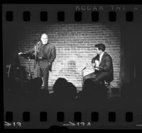 Minister Malcolm Boyd with guitarist, Raul Lara on stage at the hungry I, in San Francisco, Calif., 1966