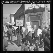 Members of the Sons of Watts picketing Worker's International Bookstore at 92nd St. and Compton Ave. in Watts, Calif., 1966