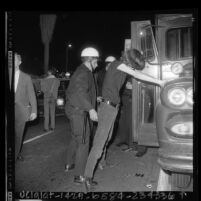 Youth being searched by police during crackdown on the Sunset Strip, Los Angeles, Calif., 1966