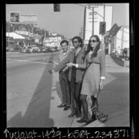Three youths hitchhiking on the Sunset Strip, Los Angeles, Calif., 1966
