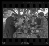 "Group of people serving tea and rice during interfaith ""Fast for Peace"" at Whittier Central Park, Calif., 1967"