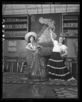 Mrs. S. A. Guiberson and Aurora Magallon wear costumes for Fiesta Pan-Americana in Santa Monica, Calif., 1949