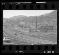 Automobiles passing billboards along Ventura Freeway near Agoura Hills, Calif., 1967