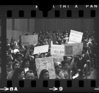 People holding up signs opposing annexation of Dominguez at Los Angeles County Local Agency Formation Commission meeting, Carson, 1967