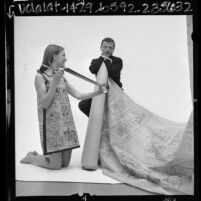 Cartoonist Frank Interlandi with model wearing cartoon dress, Calif., 1967