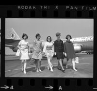 Five flight attendants modeling mod inspired and culturally influenced uniforms, Calif., 1967